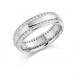 white gold eternity ring with diamonds on sides